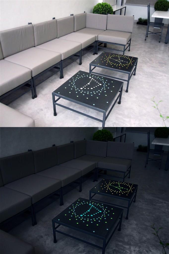 Tavolino in granito nero con segni zodiacali intarsiati luminescenti